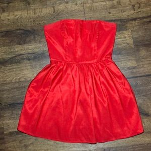 Red strapless mini dress with boning